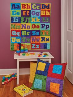 MY ALPHABET by Jean Nolte: This quilt pattern is so precious, we know you will want to include it in your home decor. We've included instructions for both a cute alphabet quilt pattern and a pillow so you can personalize a favorite child's room. We include complete instructions for these pieced and fusible-appliqued projects. If you're looking to find the perfect quilt to make for a baby shower or for a gift for a young child, look no further than this adorable quilt.