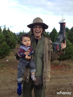 """Matthew Gray Gubler's, photo,""""me holding a dangerous saw and a baby with a glove on"""