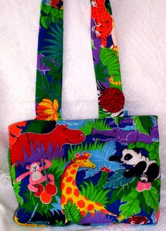 Childrens Tote Bag  Kid's Toy Bag  Library by UniqueSewingBoutique. Zoo animals, so cute, get the books and read about them.