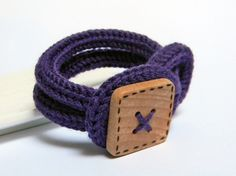 Purple knitted wool yarn bracelet Noemi, handmade square wood button, knitted jewelry.. €18.00, via Etsy.