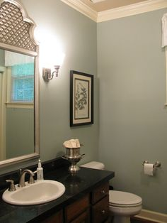 "It's Sherwin Williams ""Silvermist.""   It's relaxing and bright, and it looks great with the black counter and the wood floor and cabinets."