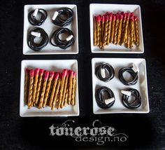 Fireman party ideas !   Perfekt til brannmannbursdag - saltstenger laget til fyrstikker!!! knekk de i passe lange størrelser og dypp tuppen i smeltet rød candy melts! (eller hvit sjokolade farget rød) Små brannslanger laget av lakris-snører som har fått en liten tut laget av hvit marsipan =)