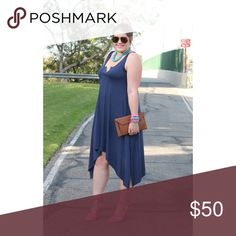 Navy Rachel Pally Dress This navy Rachel Pally jersey dress has an uneven shark-bite hemline and Henley neckline. It is SO comfy and super easy to throw on with a pair of sandals when you're running out the door! Runs a little large. Rachel Pally Dresses Midi