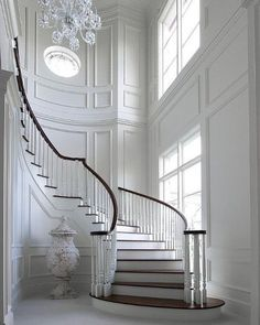 Unbelievable white entry foyer and curved staircase, fabulous trim. Maybe change the floor color n the wall for my entry n stairs Home, Inspired Homes, House Design, Entry Foyer, Interior, Traditional Staircase, Wall Molding, House Interior, Luxury Homes