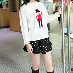 Price:$30.99 Color: Blue/White Material: Acrylic Leisure Sweet Cartoon Figure Print Knit Sweater