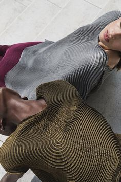 Issey Miyake A/W14- photograph by Quentin Saunier- the fluid stitch work seen over the bodices has a beautiful sense of movement and texture. Although it is different to the geometric structure seen through my concept the texture created is still a vital form of inspirational/ research.
