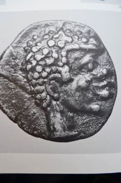"""Head of a Negro"" Silver coin from ancient Greece (Delphi). V century B.C.E. The black man depicted is ""Delphos,"" the eponym of Delphi. The father of Delphos in one ancient story was Apollo; in another, Poseidon. The ""Delphic Oracle"" occupied an important ancient seat of prophecy at Delphi. (submitted by James Brunson)"