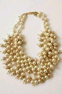 Bib pearl necklace is the only statement for jewelry on your big day. Aside from the band.