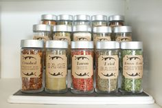 DIY: Spice Cupboard. 3/$1 bottles at the Dollar store, spray paint the lids, apply cute labels, stand them on a riser.