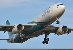 Oman Air Airbus 330 landing at London Heathrow Airport.  photo: plane-mad