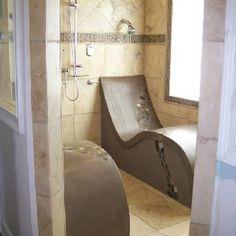 Custom tile steam shower Chris built. Heated custom made lounge chairs.