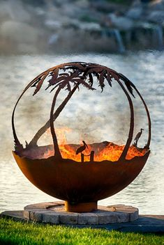 Another Day in Paradise Palm Tree Steel Outdoor Fire Pit Sphere with Flat Steel Base.Palm trees, pelican and crane shorebirds and seagulls capture the feeling of this tropical paradise fire pit sphere. Fire Pit Sphere, Diy Fire Pit, Fire Pits, Tree Wallpaper Green, Palm Tree Quotes, Tree Of Life Meaning, Oak Tree Tattoo, Custom Fire Pit, Number Art