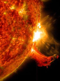 NASA's Solar Dynamics Observatory captured this image of a solar flare on Oct. The solar flare is the bright flash of light on the right limb of the sun. A burst of solar material erupting out into space can be seen just below it. Cosmos, Hubble Space Telescope, Space And Astronomy, Fuerza Natural, Les Satellites, Nasa Goddard, Hubble Images, Hubble Pictures, Whirlpool Galaxy