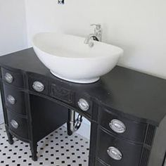 How to Turn a Desk into a Sink {repurpose}Renovating your bathroom on a budget can be a challenge! Learn how to repurpose a desk into a gorgeous vanity with this helpful tutorial.View This Tutorial