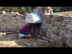 Jens removing the false work from Dry Stone Arch, built in a Dry Stone Retaining…
