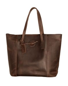 - Distressed dark chocolate baseball glove leather brings this tote to the forefront of off the field baseball style. Tote Features: - Large interior canvas zip pocket - Two small canvas pockets - Bas