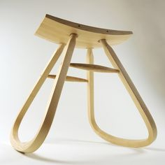 DEFINITION: Unstable stool, isn't reliable or functional in any proper environment. WHY: The rounded legs makes the stool rock back and forth, and creates lack of support; if someone where to sit on it, it seems the stool would split in half.
