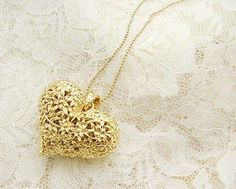 Love this gold heart necklace, looks like lace