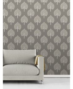 This Annabelle Tree Wallpaper has a stylish tree pattern in white with touches of yellow on a matte grey background. Free UK delivery available Tree Themed Wallpaper, Tree Wallpaper Grey, Wall Wallpaper, Unique Trees, Tree Patterns, Free Uk, Gray Background, Wall Decor, Delivery