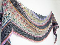 Paid Jewel is a soft crescent shaped shawl that uses a long colour change yarn to adorn the shawl with jewels of colour.