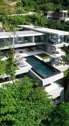 Modern style 3-story house with Full-Glass Exterior Walls on 3rd floor, and outside pool on 2nd Floor