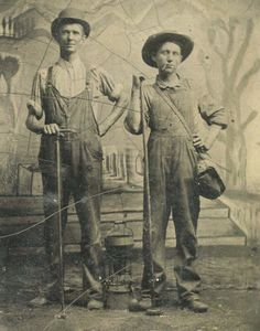 occupational, lamp lighters? or are they holding some sort of floor rammers