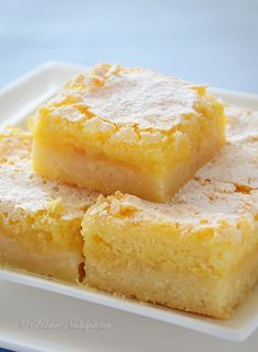 Lemon Squares - not too sweet lemon bars with thick shortbread crust and tangy lemon curd filling