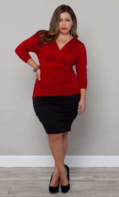 Simple, sexy and sophisticated.  The Plus Size Sadie Ruched Top by Kiyonna is available in a vibrant Red-y For Love color.  We like it simply paired with a basic black pencil skirt. #Kiyonna #KiyonnaPlusYou #PlusSize