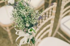 Gypsophila and lissianthus chair posies -   Image by  Neil  Jackson…