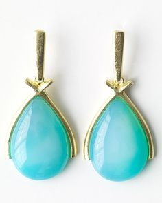 Oversize Caribbean-blue teardrops are especially striking when encased in wishbones of gold