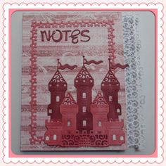 An inexpensive notepad decorated with Tim Holtz papers and Tattered Lace die cuts