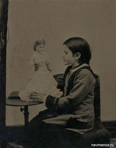 Another dead child and doll image. This girl looks as if she's been dead for a while.