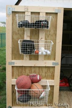 Hang baskets on the inside of your shed doors to store sports balls and equipment. Great to hang sprinklers, gloves, garden pruners, etc.