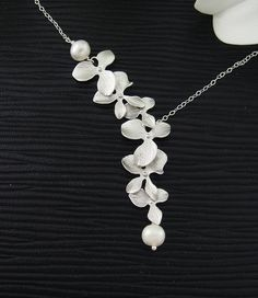 Hey, I found this really awesome Etsy listing at https://www.etsy.com/listing/77130809/orchids-flower-necklace-freshwater-pearl