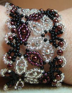 Spanish Lace Beadwoven Bracelet  Silver & Eggplant by jenjohnson42, $20.50  This is beautiful!!
