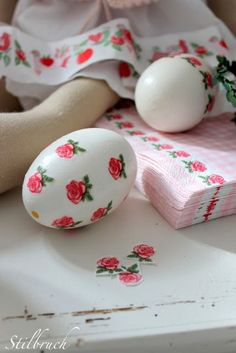 Cut pieces out of patterned napkins and use white glue to seal them to the egg... brilliant!