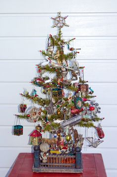 Antique German Christmas Ornaments on a antique feather tree..... Alter Christbaumschmuck