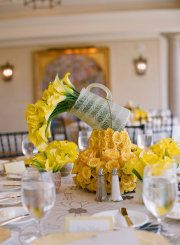 Love this watering can floral centerpiece for a bridal shower!