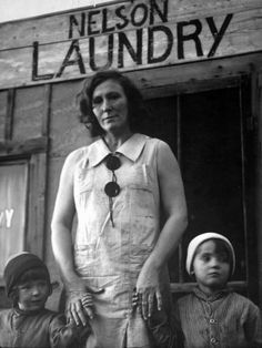 Nelson with Her Two Children Outside Her Laundry Which She Operates without Running Water by Margaret Bourke-White :