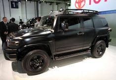 Fj Cruiser - Can someone buy this for me? Blacked out... But I want pink underglows and halos. Birthday gift to Kristin? Pretty please. Just dreaming big here.