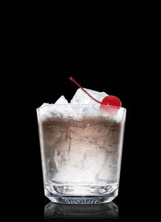 Absolut Black Russian - Fill a chilled rocks glass with ice cubes. Add all ingredients. Garnish with a maraschino berry. 2 Parts Absolut Vodka, 1 Part Kahlúa, 1 Whole Maraschino Berry