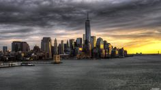 Here is lower Manhattan with the freedom tower clearly visible just before sunset. Manhattan Wallpaper, New York Wallpaper, City Wallpaper, Sunset Wallpaper, Dark Wallpaper, Desktop Wallpapers, Lower Manhattan, Hudson New York, The Freedom Tower