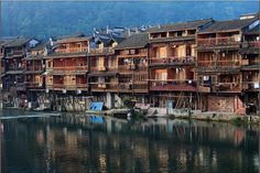Stilt house (diaojiao house) along the River Stilt House, House On Stilts, Lost City, Underwater, River, Mansions, House Styles, Manor Houses, Under The Water