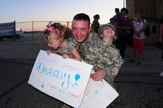 KFOR Homecoming at Fargo-109    North Dakota Army National Guard soldier Spc. John Stautz is greeted by his son John and his daughter Sienna, upon his return to Fargo, N.D., after a one-year deployment to Kosovo. The Soldiers were part of a NATO peacekeeping mission and served in Multi-National Battle Group East, which was commanded by Brig. Gen. Al Dohrmann, of Bismarck, N.D. (DoD photo by Senior Master Sgt. David H. Lipp) (Released)