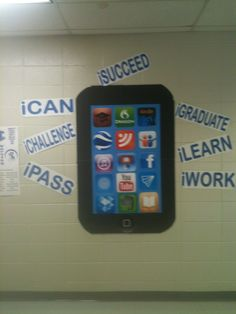 """IPad made from foam board! Taped 4 pieces of black foam board together; taped down two pieces of blue poster board; printed out icons, smart button, and """"i"""" phrases. Hung finished iPad with 3M command strips."""