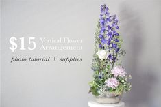 Make a big impact with a small flower budget! Learn how to make a tall flower arrangement with the right mix of flowers and foliage.