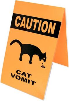 "Cat Vomit Warning Sign Designed by Ellen Gibbs -- Says ""Cuidado: Vomito de Gato"" on the other side."