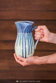 This is our handmade ceramic pitcher in the new Blue Mint Green glaze. We just added it to our store, you are welcome to check it out! This makes a great Wedding gift, Housewarming gift and New home gift! Whether your kitchen is rustic or modern, this beautiful pitcher will look great, especially with coastal kitchen decor! by Blanket Creek Pottery. #CeramicPitcher #PotteryMug #CeramicServeware #HostessGift #ServingGift #HousewarmingGift #HandmadePottery Handmade Ceramic, Handmade Home, Handmade Pottery, Mint Green Decor, Orange Home Decor, Aqua, Turquoise, Teal, Pottery Gifts