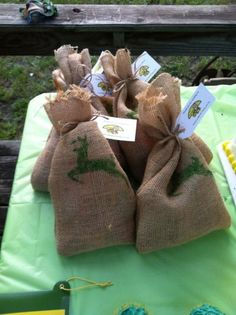 DIY John Deere burlap bags make the perfect farm themed party favor presentation. See more John Deere birthday party ideas at www.one-stop-party-ideas.com