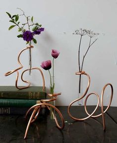 copper rack with test tubes and flowers